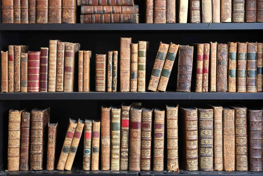 hemp resource library - old books on wooden shelf
